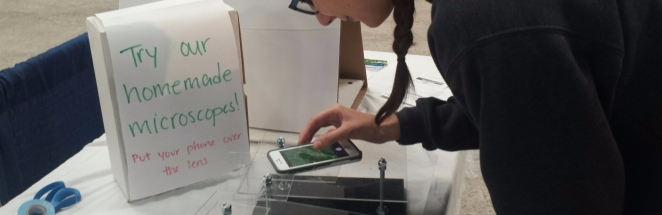 Tuesday Simmons demonstrating the homemade stand that turns your phone into a microscope at the North Bay Science Festival in Sonoma. Oct. 28, 2017