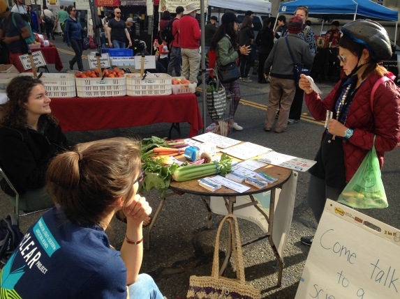 Downtown Berkeley Farmers' Market - sharing information with a visitor